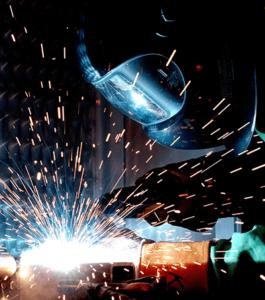 image of man welding to repair tank